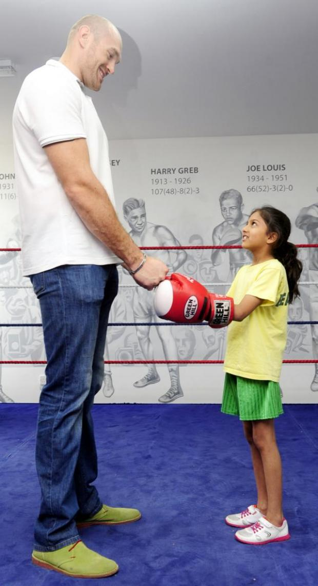 The Bolton News: Boxing giant Tyson Fury with little Saadia Shama of Beaumont Primary School