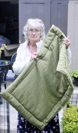 Barbara Green with one of her dog blankets