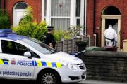Police and forensic experts at David Knowles' house in Bolton Road, Farnworth