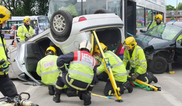 Firecrews from Bolton, Horwich and  Farnworth act out a road collision during the training exercise