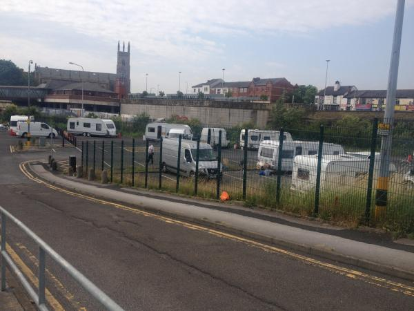 Travellers set up camp next to Bolton railway station