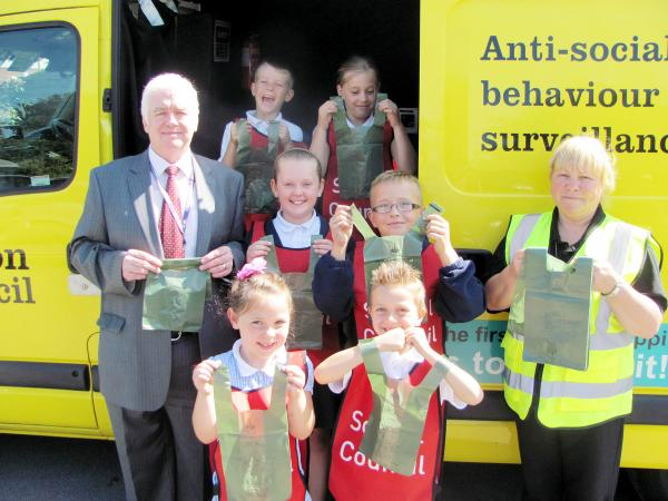 With Cllr Derek Burrows and Christine O'Reardon are, back to front, left to right: Theo Valentine, aged eight, Issy O'Loughlin, aged eight, Megan Dilworth, aged 10, Josh Hark, aged 10, Imogen Conroy, aged six and Oliver Price, aged six