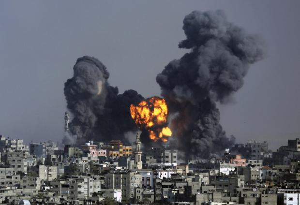 Smoke and fire from the explosion of an Israeli strike rise over Gaza City on Tuesday.