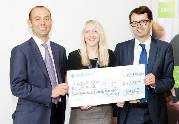 Ed Stapley, head of marketing at Capita Children's Services, Lauren Reynolds with her cheque and Paul Carbury, chief executive of The SHINE Trust