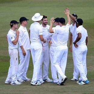 James Anderson, fourth left, celebrates with his team-mates after taking the wicket of Virat Kohli