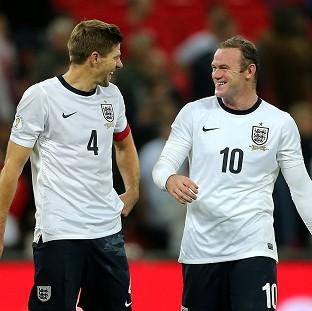 Rio Ferdinand believes Wayne Rooney, right, should succeed Steven Gerrard as England captain
