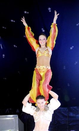 Victoria Jackson on the shoulders of fellow acrobat Brad