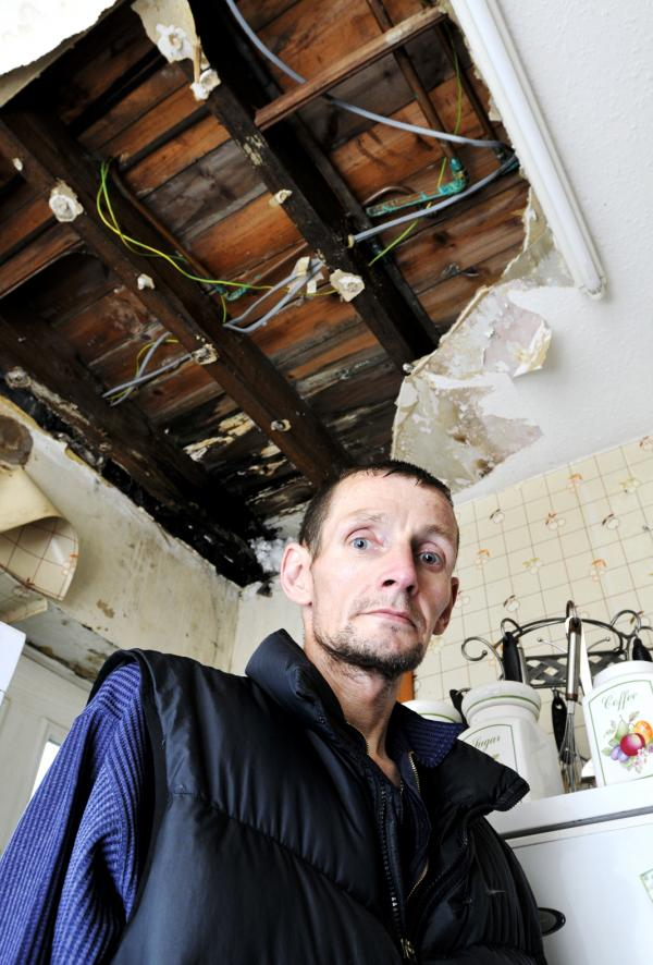 Dad and son waiting a month for Bolton at Home to fix massive hole in kitchen ceiling