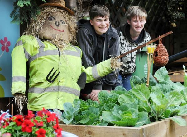 Residents use house in Johnson Fold to grow their own fruit and veg