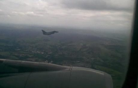 The RAF Typhoon fighter jet escorting the Qatar Airways plane as it comes in to land at Manchester Airport. Picture from video shot by passenger Josh Hartley.