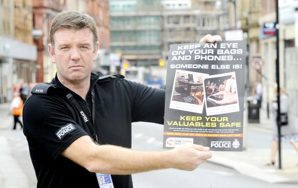 PC Andy Vernon with one of the leaflets being handed out by police