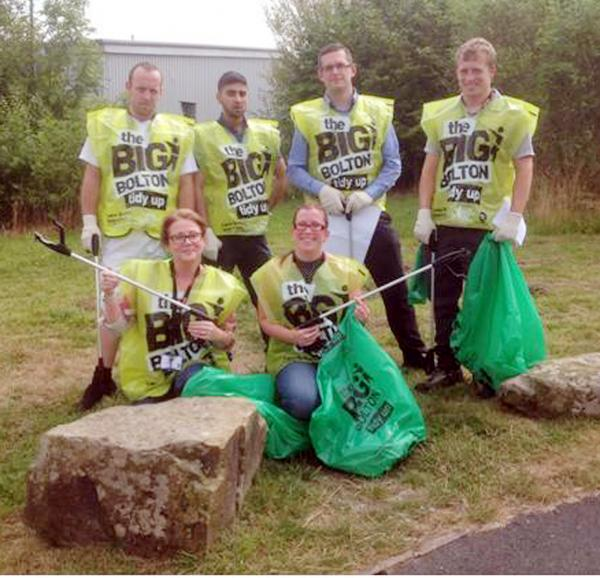 Staff of Stateside Foods picking up litter in Westhoughton