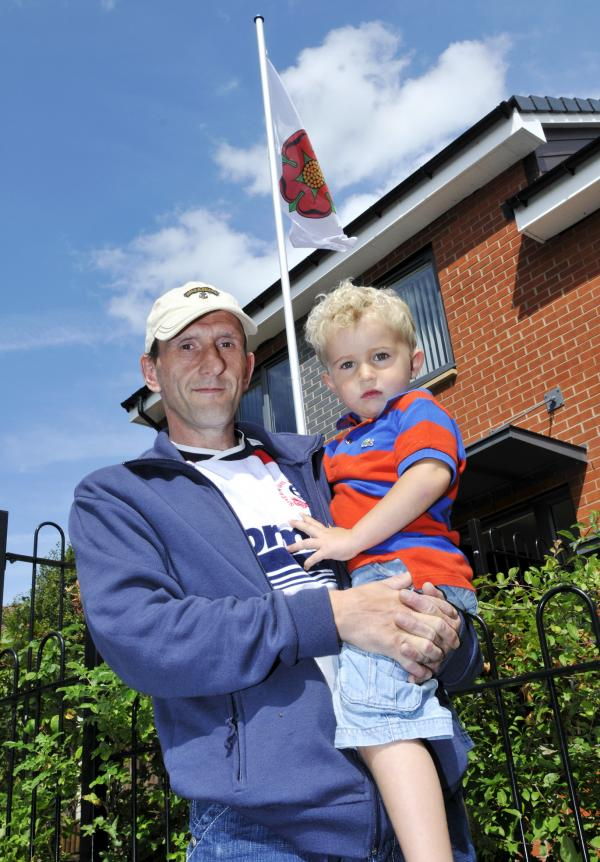 Johnson Fold dad refuses to take down flag pole despite order from Bolton at Home