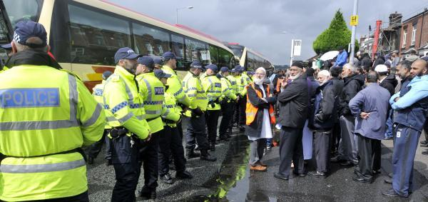 Police lined up in front of counter-protesters as the North West Infidels held a demonstration in Blackburn Road