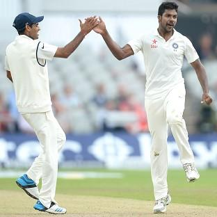 Varun Aaron, right, celebrates taking the wicket of Moeen Ali at Emirates Old Trafford