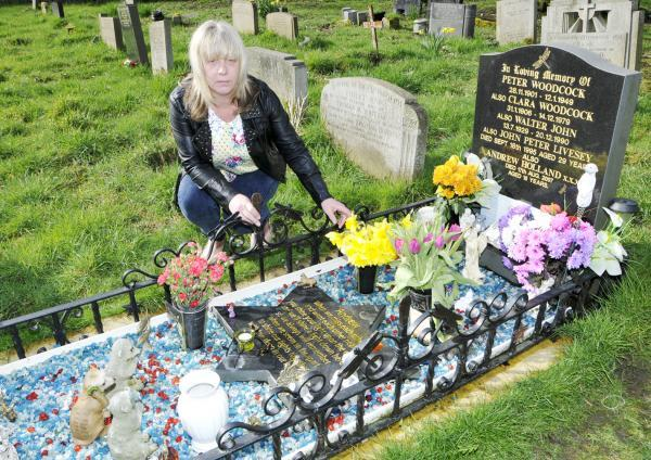 Joan Holland at the graveside of her son Andrew