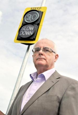 Town council leader Kevin McKeon at the 20mph zone sign