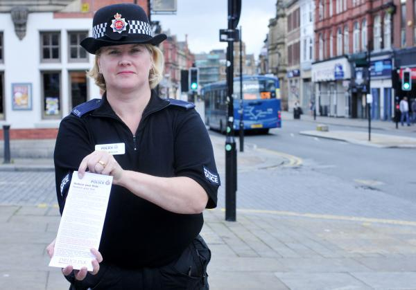 PC Jane Wilcock with a fixed penalty notice which are given for drunk and disorderly behaviour