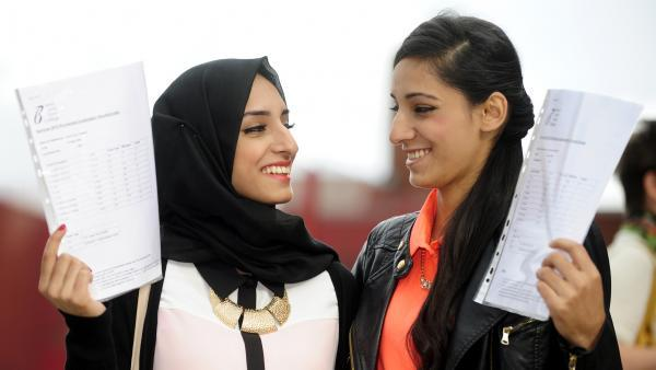 Aria and Alia Khan with their A-level results