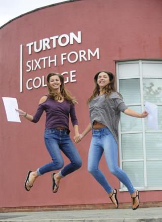 Charlotte and Aimie Bowles from Turton Sixth Form show their delight