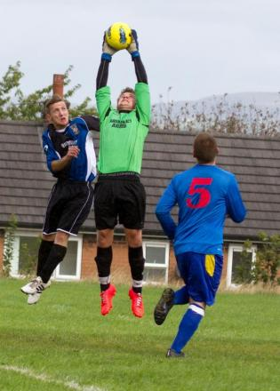 Brindley Arms keeper Ryan Reynolds comes under pressure from Rumworth Hall's Chris Carkaldy