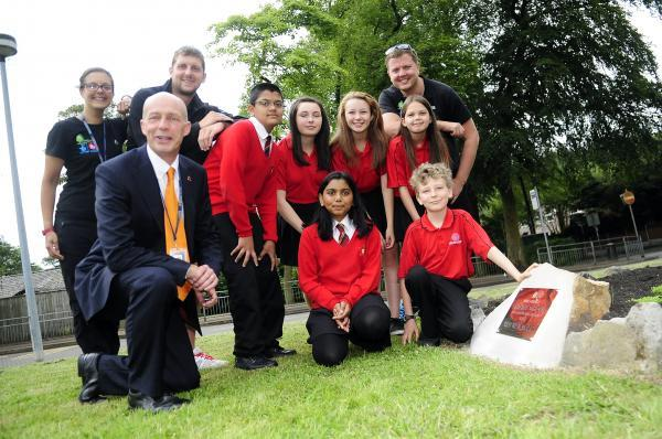 Headteacher Alec Cottrill with teachers, from the left, Malini Craig, Andrew Scholefield and Stuart Pearson. Youngsters from the left top are Ansar Lala, Kia Stones, Emily Affleck and Isobella Saunders. Front, from the left are Jyotika Bhojani and Matthew
