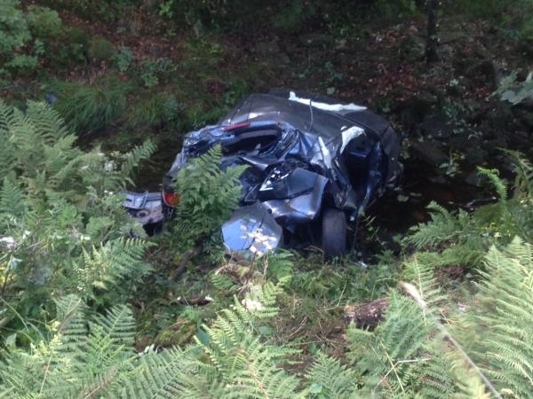 UPDATED: Car plunges down embankment near Belmont