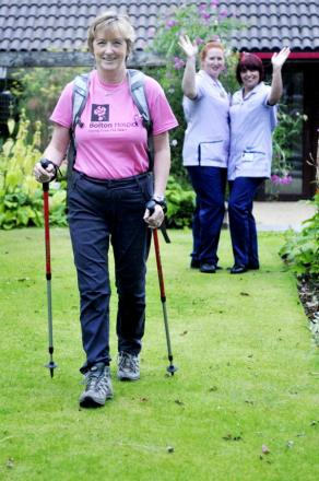 Judith Bromley is waved off by nurses Lynda Adamson, left, and Jacqui Ryder, right