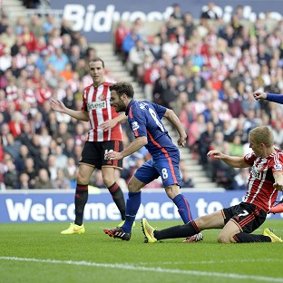 Juan Mata, second from left, scores Manchester United's goal but Sunderland hit back to equalise