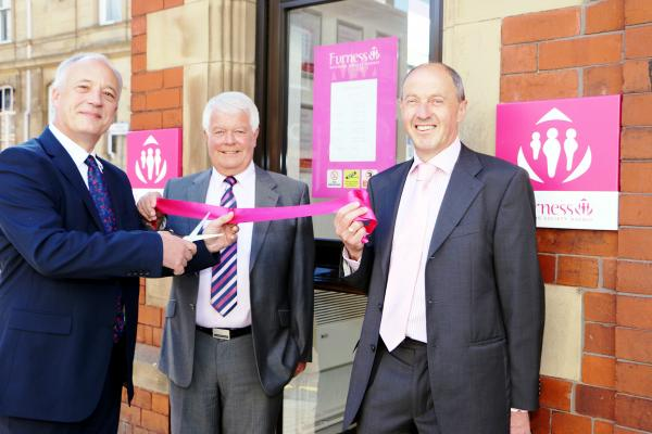 Furness Building Society chief executive Nigel Quinton, left, cuts the ribbon with Alan Leach, centre, and Ray Hamer