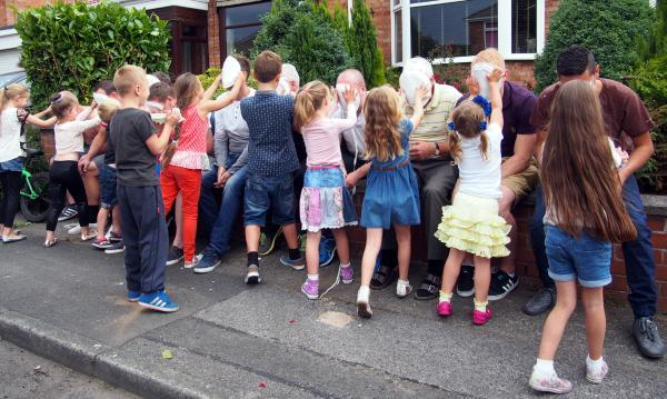 Bradshaw street party raises £1,000 for hospice - and dads get cream pies in face