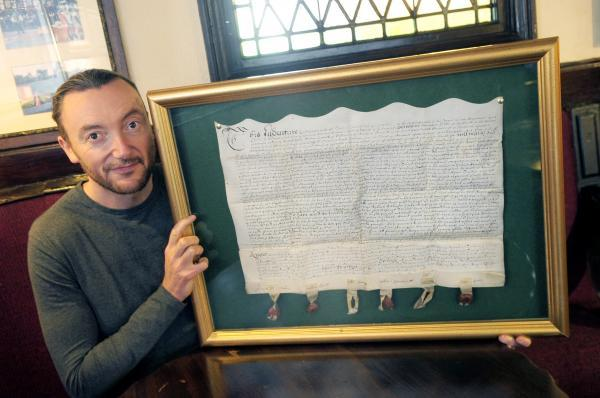 Richard Greenwood of Ye Olde Man and Scythe with the document