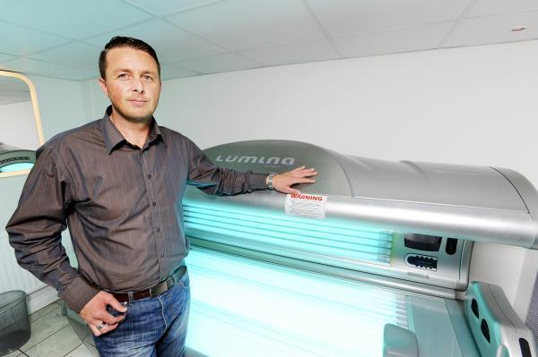 James Scott, who has opened a tanning and beauty salon