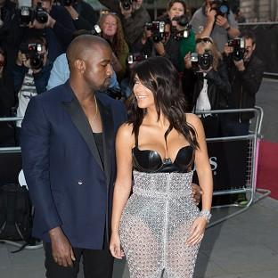 Kim Kardashian and Kanye West arrive at the GQ Men of the Year Awards
