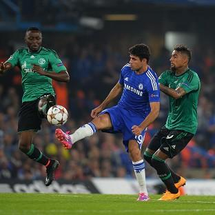 The Bolton News: Chelsea's Diego Costa is tackled by FC Schalke's Kevin-Prince Boateng (right) and Chinedu Obasi during the UEFA Champions League, Group G match at Stamford Bridge, Liverpool.