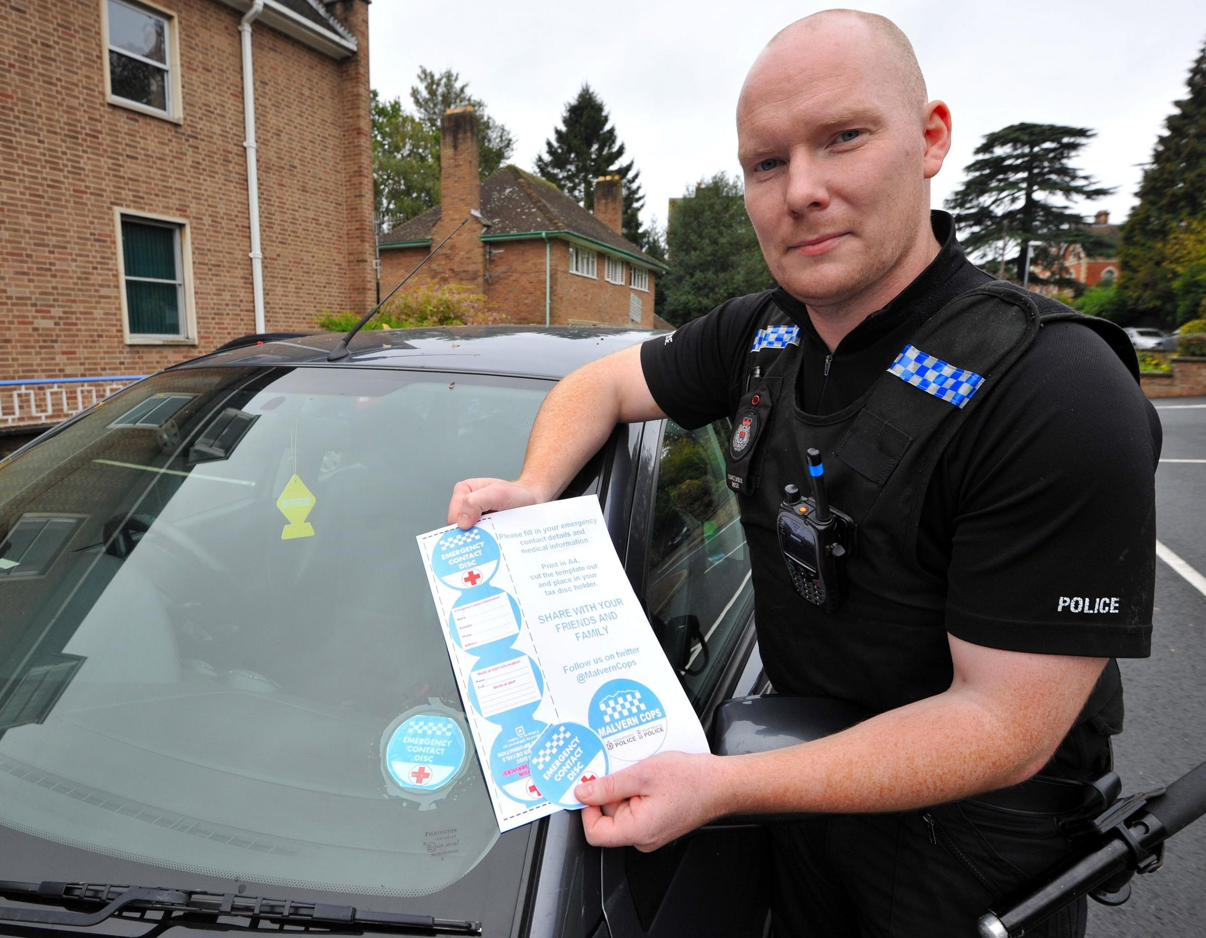 PC Dave Wise with the innovative tax disc holder medical information card.