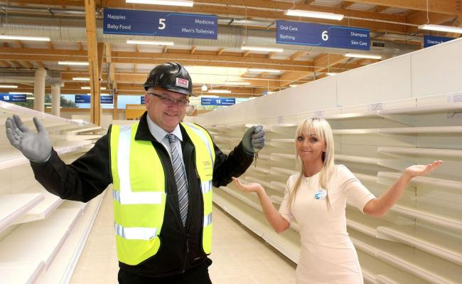 Site manager Grahame Holden with store manager Karen Shaul