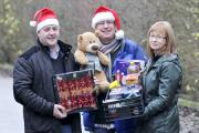 Allied Carpets unit, nr Toys R US, next to St Peters Way  Urban Outreach volunteers sorting Chrismas food  ahead of the hampers for delivery. In this photo, front, Alan Holt ,Dave Bagley (Chief Executive) and Gaynor Holt.   Picture by Richard Holton Newsq