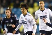 Chung Yong Lee in action with Millwall's Shaun Williams