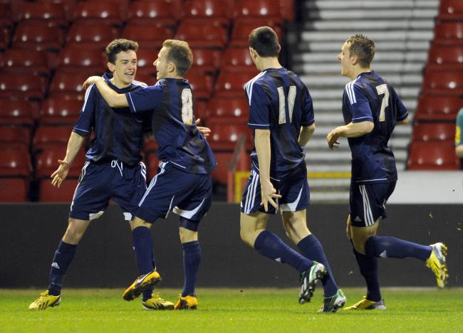 MEMORABLE: Zach Clough, left, celebrates scoring at Nottingham Forest for the Wanderers youth team in 2013