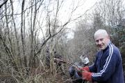 CLEAN UP: Alan Kemp at work at Eatock Lodge, Westhoughton, where residents are sprucing up the area to help look after it in winter by clearing out litter and weeds.