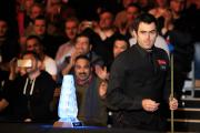 Ronnie O'Sullivan walks past the trophy as he walks out for the start of his match against Marco Fu during day five of the 2015 Dafabet Masters at Alexandra Palace, London. PRESS ASSOCIATION Photo. Picture date: Thursday January 15, 2015. See PA story SNO