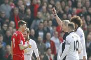 Steven Gerrard is shown red by referee Martin Atkinson at Anfield on Sunday