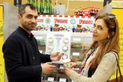 Business partners Hakan Bayram and Parisa Para of Moda Hairdressers, Newport Street, paid a visit to the pick 'n' mix stall
