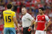 Referee Jon Moss talks with Crystal Palace's Mile Jedinak (left) as Arsenal's Mikel Arteta looks on. Moss will renew acquaintances with Arsenal in the FA Cup final.