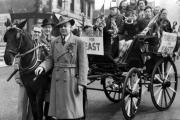 This chap is Winston Crumblehulme, the Conservative candidate in East Ward, in May 1951. He has a wagonette load of young supporters in the vehicle, which was said to be 100 years old