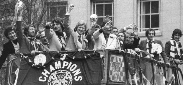 The Bolton News: Roy Greaves holds the Division Two championship trophy aloft as the players enjoy an open-top bus parade following their title triumph in 1977-78