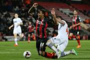 Dorian Dervite brings down Bournemouth's Callum Wilson to earn a red card on Monday