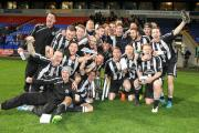 Atherton Collieries celebrate their Hospital Cup success at the Macron Stadium