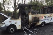 The minibuses, belonging to Premier Minibuses, that were set on fire at a compound in Farnworth. Picture: Naz Ali